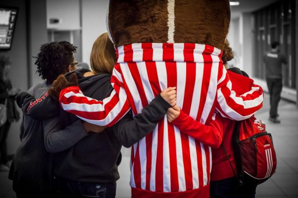 students hugging Bucky